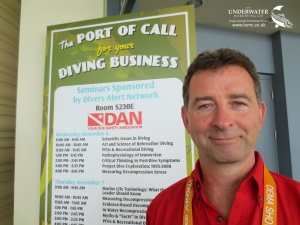 DEMA Show 2013, Dr Neal W Pollock, headshot outside DAN lecture room, Rosemary E Lunn, Roz Lunn, The Underwater Marketing Company, TTE, diving physiology, EUROTEK, TEKDiveUSA, thermal stress, environmental researcher